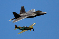 U.S. Air Force F-22 Raptor and a P-51D Mustang